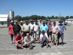 Bill Cornell with a group of Australian cattlemen at the Rishel Angus bull sale in 2012