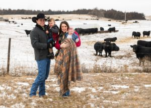 TD Angus family with angus bulls in the background